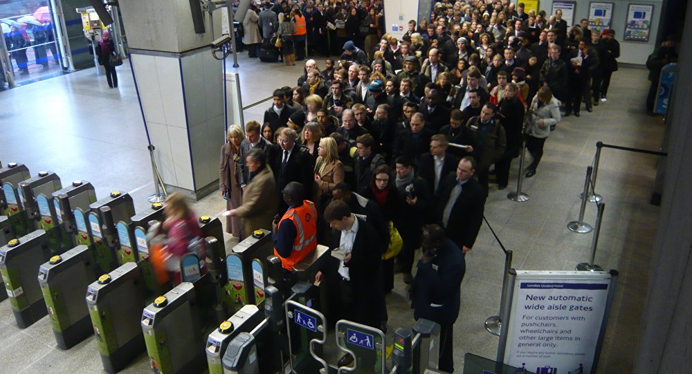 commuters queuing for the underground at waterloo station london